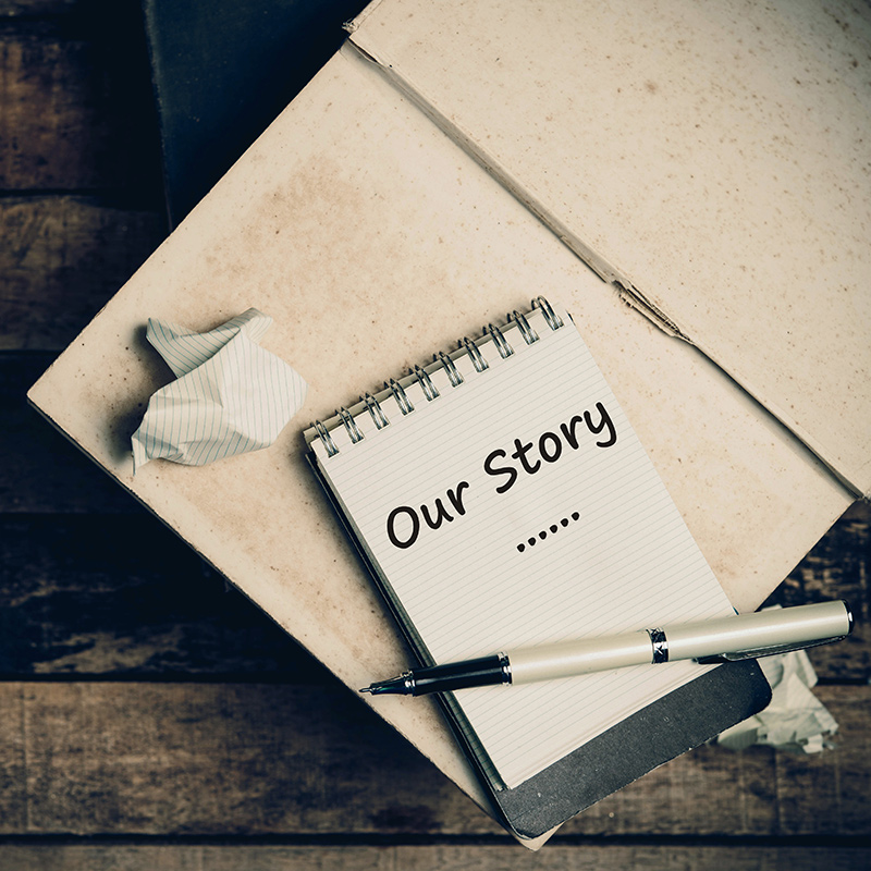 Note page with 'Our Story' handwritten upon it.
